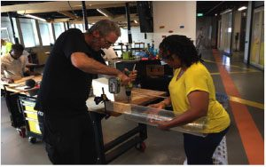 Graham Durant, training one of our African colleagues in exhibit building at Questacon