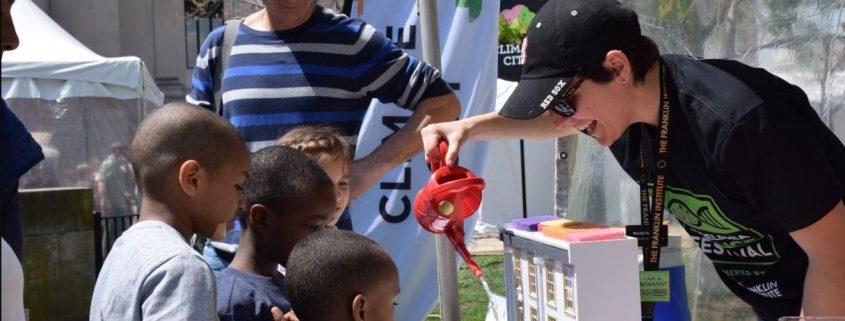 Children watching a science demonstration.