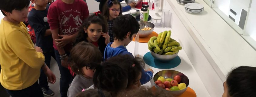 Children learn about health and nutrition while making a snack.